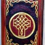 Custom made hand tooled leather book cover