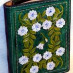 hand tooled leather book cover with flowers